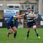 Heriots Ross Jones fends off Boroughmuirs Callum Ramm. FOSROC Super 6 match between Heriot's Rugby and Boroughmuir Bears at Goldenacre, Edinburgh on 09/10/2021. (Photo: 39 Design Photography)