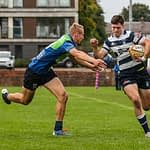 Heriots Ben Evans drives towards the line as Boroughmuirs Duncan Munn tries to make the tackle.FOSROC Super 6 match between Heriot's Rugby and Boroughmuir Bears at Goldenacre, Edinburgh on 09/10/2021. (Photo: 39 Design Photography)