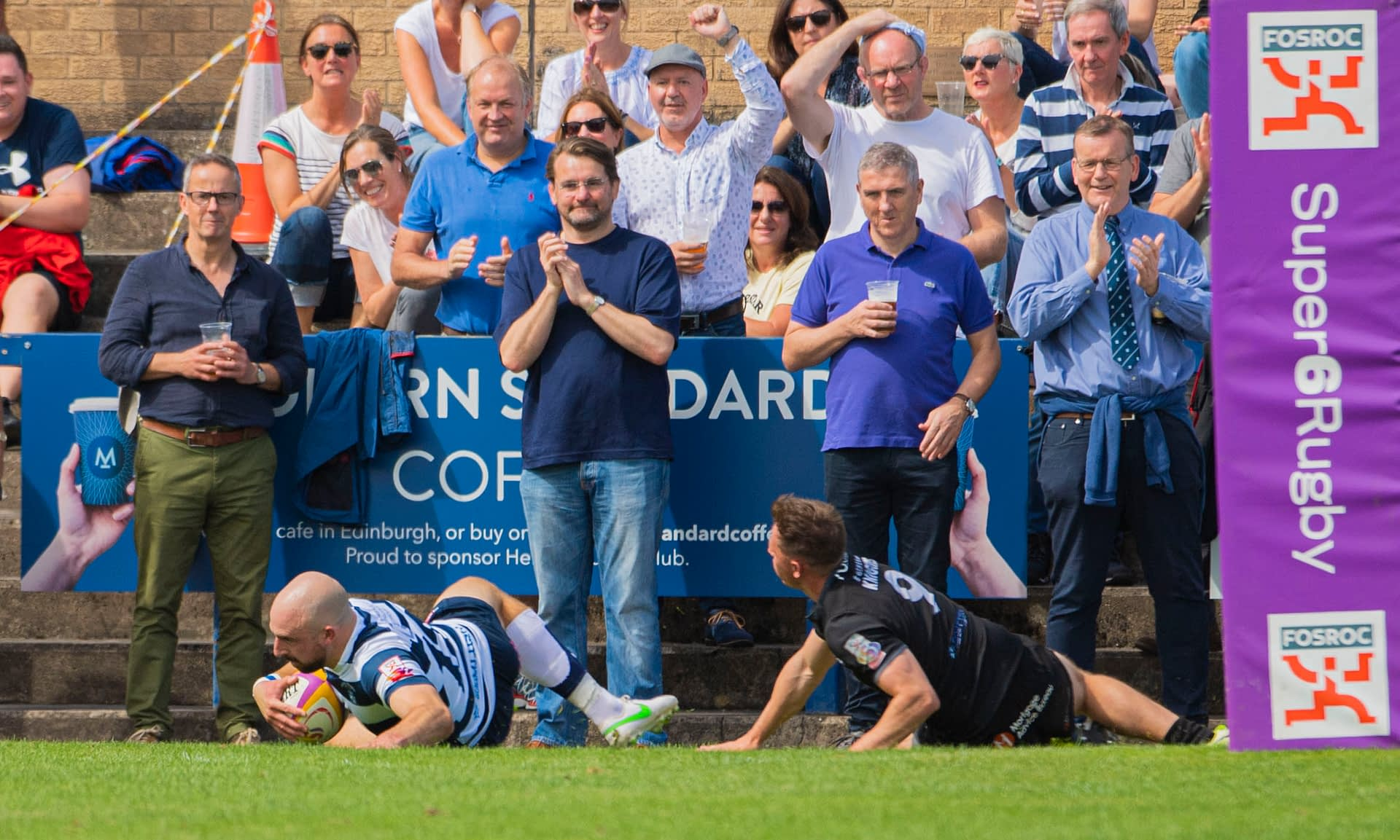 EDINBURGH, SCOTLAND - AUGUST 08: Heriot's Stuart Edwards with a try in front of the fans during a FOSROC Super6 match between Heriot's and Southern Knights at Heriot's Rugby Club, on August 08, 2021, in Edinburgh, Scotland. (Photo by Paul Devlin / SNS Group)