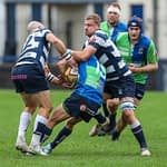 Heriots Jason Hill and Iain Wilson tackle Boroughmuirs Tom Brown during the FOSROC Super 6 match between Heriot's Rugby and Boroughmuir Bears at Goldenacre, Edinburgh on 09/10/2021.   (Photo: 39 Design Photography)