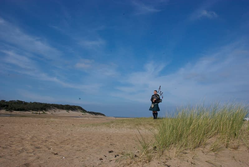 bagpipe player on the beach